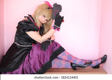 game uniform costume young woman in pink room