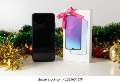 Smarthphone with gift bow for Christmas