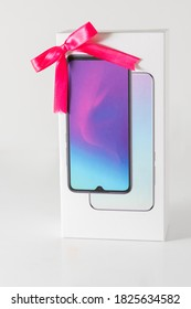 Smartphone box  with gift bow for Christmas