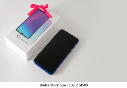 Smartphone  with gift bow for Christmas