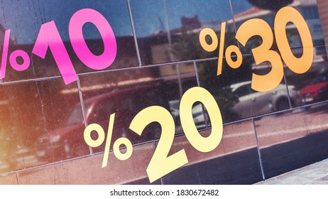 10, 20 and 30 percents discount signs on glass of window case of fashion store outdoors