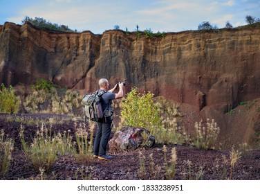 Professional photographer shooting inside the calder of an extinct volcano