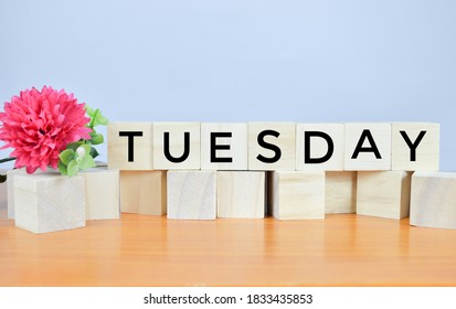 TUESDAY word written on wood block. Happy Tuesday concept.