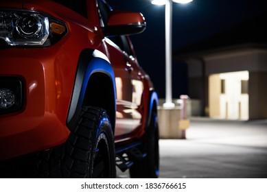 Toyota Tacoma orange at night
