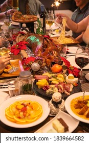 Roast pig holiday dinner feast. Philippines Lechon. Charcuterie, wine, pizza, and fruits.