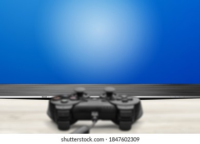 Black classic Playstation game controller on the desk