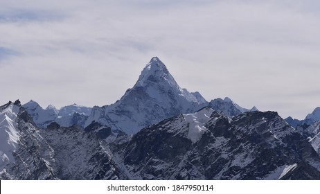 Stunning panorama view over snow-capped Himalayan mountain range with majestic Ama Dablam (summit 6,812 m) on sunny day with clouds viewed from Kala Patthar, Sagarmatha National Park, Nepal,