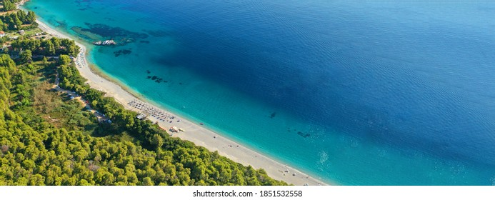 Aerial drone ultra wide panoramic photo of tropical paradise deep turquoise lagoon with beautiful seascape in exotic destination island