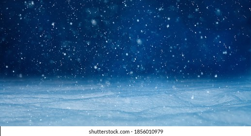 Christmas background with falling snow, selective focus. Beautiful Winter night landscape. Nature Winter background with Copy Space for design.