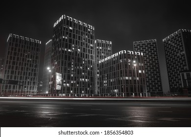 Multi-storey buildings of the night city in the fog