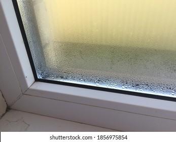 Fogged plastic window with condensation