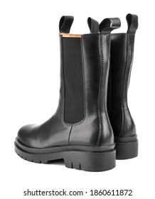 Women's shoes on a white background. Close up of a women's black leather chelsea boots on white background. Footwear for city, urban lifestyle or traveling. Concept of fashion, design and footwear.