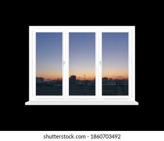 Ventana panorámica con vista del atardecer rojo sobre los edificios de la ciudad aislados en negro. Paisaje de noche. Hermosa vista desde la ventana de la habitación. Chimeneas con humo sobre la ciudad al atardecer. Crepúsculo en la ciudad