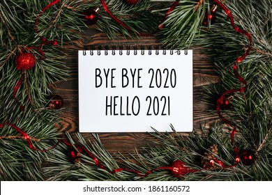 Merry christmas and merry new year concept with gift boxes, toys and notebook with text Bye bye 2020 Hello 2021