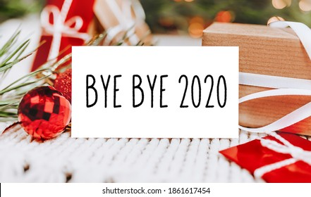 Merry christmas and merry new year concept with gift boxes and greeting card with text Bye bye 2020