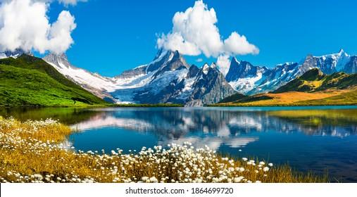 Sonnenaufgang auf Berner Bergkette über dem Bachalpsee. Gipfel Eiger, Jungfrau, Faulhorn in berühmter Lage in den Schweizer Alpen, Grindelwaldtal