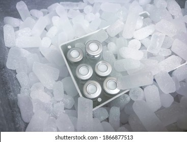 Closeup on vials with crimp caps placed on dry ice prepared for medical transport. Selected focus.