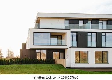 22.10.2020. Riga, Latvia Mezaparka Rezidences: Modern buildings with big glass windows black and white small trees, good neighborhood, modern city, suburb.