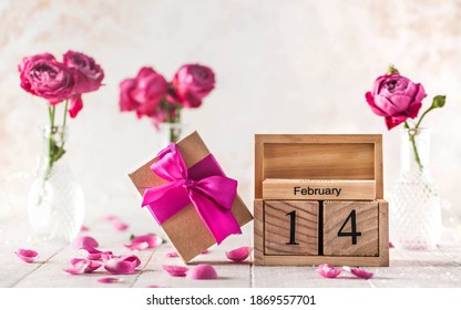 February 14 calendar, gift, roses and rose petals. The concept of Valentine's Day.