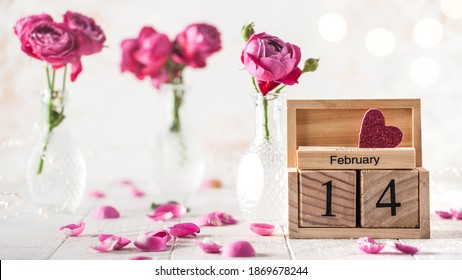 February 14 calendar, roses and rose petals. The concept of Valentine's Day.