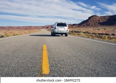 Silver SUV driving in Utah.