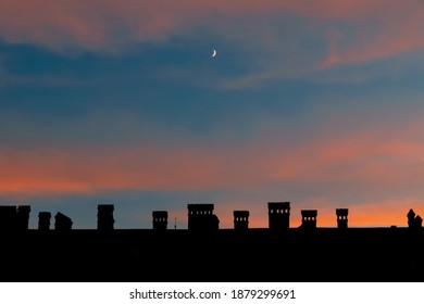 beautiful evening landmark wallpaper building urban view with chimney roof and picturesque sunset sky purple orange and blue color with young moon and empty copy space for your text here
