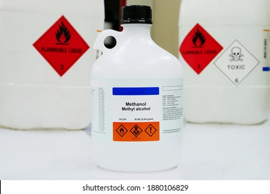 Bottle of Methanol, methyl alcohol, MeOH with Properties information and Variety type of chemical containers with its chemical hazard warning symbols. Flammable warning symbol, Toxic warning symbol.