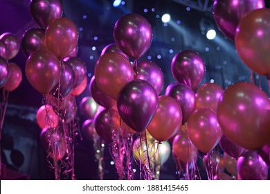 A large number of celebration and party colorful christmas baloons with pink ribbons. Event decoration. New year eve. Christmas party. Celebration