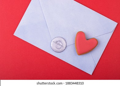 blue envelope with a wax stamp of love and a red heart on a red background. love letter, background for Valentine's day, mother's day