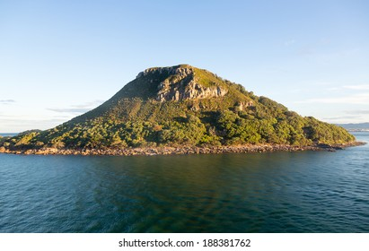 Leaving Tauranga Harbour with view of the side of The Mount in New Zealand
