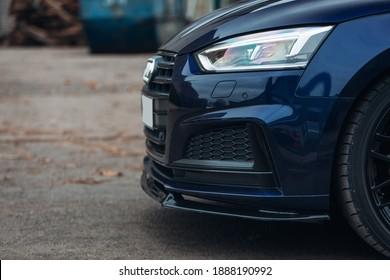 Modern sport car front bumper lip, spoiler, and splitter