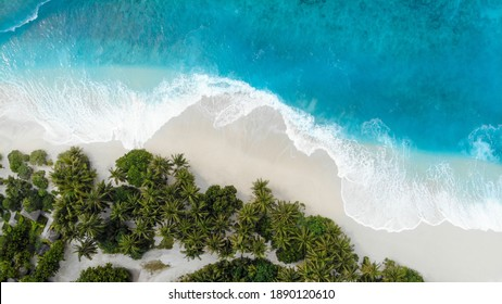 Aerial Drone Photo of waves crashing on the beach in Forkland (Fuvahmulah) in Maldives
