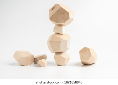 Tumi-ishi puzzle game. Construction of an unstable wooden block tower. The process of the game. Stones for Rock Balance.
