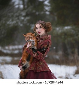 Art photo of a woman in red and red fox