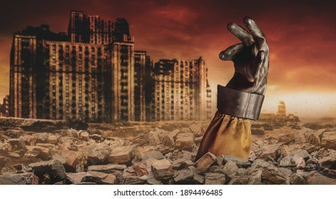 Photo of a stalker hand in rubber glove buried under bricks on desolate destructed  apocalyptic city.