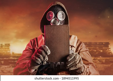 Photo of stalker soldier in soviet gas mask holding closed old book on destructed ruined wasteland background.