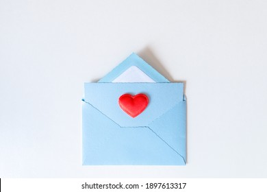 Red heart on a blue envelope for Valentine's Mother, Women's day. Love letter. Gratitude to doctors and nurses.Top view. Flat lay. Copy space