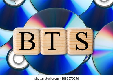 BTS concept with wooden cubes. BTS word on CD background