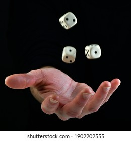 Female hand throwing dice in the air on black background. Fortune concept playing dice. luck concept. lucky man