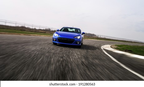 Blue sport car on race way. Motion capture.