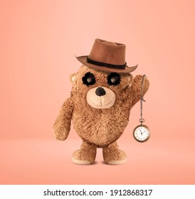 The plush bear is waving an antique pocket watch. Fedora. The plush bear character has been reinterpreted with photo manipulation. Cute plush bear. 3D drawing. Plush bear character design.
