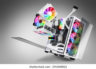 exploded view of white gaming pc computer with glass windows and rainbow rgb LED lights. Flying hardware components abstract technology concept on gray background