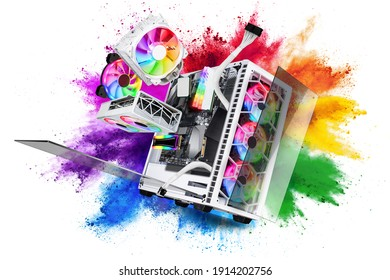exploded view of white gaming pc computer with glass windows and rainbow rgb LED lights. Flying hardware components in front of abstract color powder explosion on isolated background