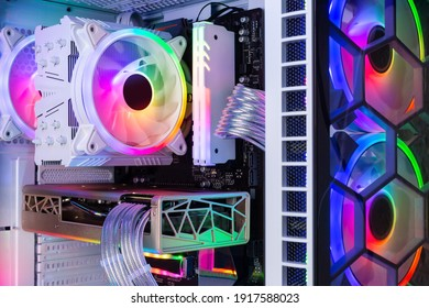 Inside view of custom colorful illuminated bright rainbow RGB LED gaming pc.. Computer power hardware and technology concept background