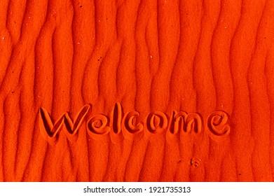 """Auf dem roten Mars-Sand steht die Inschrift """"Welcome"""". Speicherplatz kopieren. Die Botschaft der Marsmenschen an die Erde. Mars."""