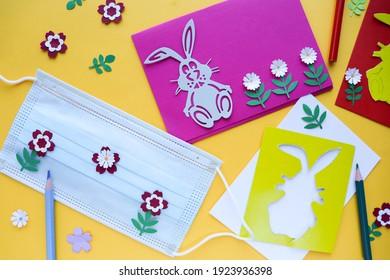検疫のイースター休暇。子供とのクラス。イースターカードを作る。医療用マスクと学用品