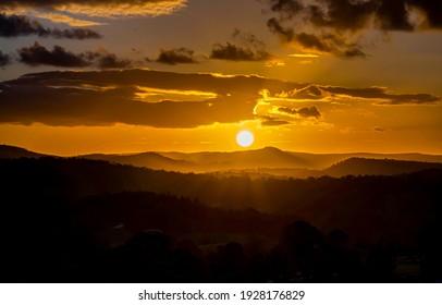 Sunset mountain valley horizon landscape. Sunset sky clouds panorama. Sunset horizon view. Sunset horizon panorama