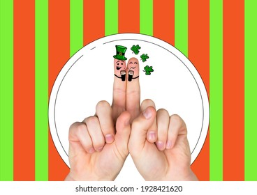 Two fingers with irish saint patrick's day themed smiling faces over red and green stripes. saint patrick's day celebration concept digitally generated image.