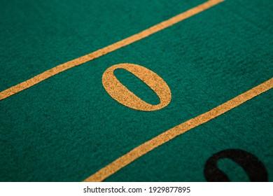 Detalle de una mesa de ruleta, con el número cero en evidencia