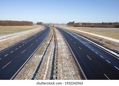 S5 expressway, highway after snowfall, vehicles lifting water droplets into the air. Early spring. Gniezno, Poland.